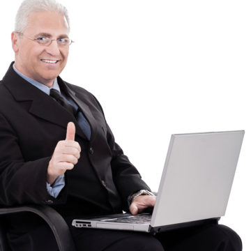 Mature business man shows thumbs up on successful business