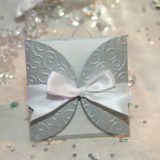 Elegant silver wedding invitation with a bow